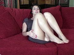This sexy slut takes off her tan pantyhose and rubs her pussy. She is getting hornier and hornier, as she rubs herself. Will she make herself cum? It's so hot to watch her play with herself. She even rubs her tits underneath her bra.