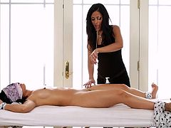 Layla Sin, who is very hot, giving the massage to an Asian girl, Cindy Starfall and help her to reach the orgasm. Layla is rubbing the Cindy's pussy with a very thin stick. The good thing is, that Cindy is tied with some clothes, so she can't move & can only enjoy the process.