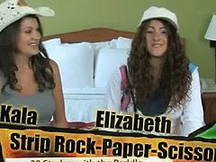 Kala and Elisabeth are playing rock, paper, scissors. The loser will get spanked on her bare ass with a wooden paddle. This is a game about luck. The winner is..