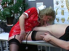 What kind of horny dude wouldn't want to have someone like this blonde bitch as their nurse? Watch her as she caresses this guy's dick using her feet with her stockings on.