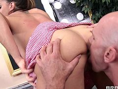 Dynamic babe with fake tits giving huge dick titjob before riding huge dick hardcore