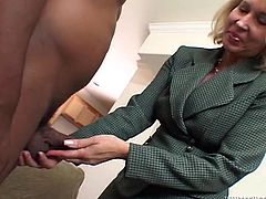 This blonde granny has stumbled into the ghetto, where she is going to suck on a great big black cock. She feels it with her hand and very quickly, she is on her knees, and slurping down that massive black cock. She bends over, to give him a good look at her pussy and ass.