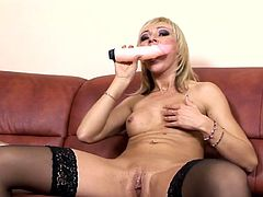 Visit official Lovely Matures's HomepageHer new toy seems to do the job right as blondie in black stockings moans like a little slut while masturbating with lust