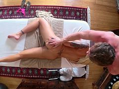 Nina Elle rewards her masseuse by giving him a blowjob