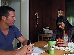 Mia Khalifa, the hottest pornstar today is ready to pop her cherry as she is together with this two black guys with two monster cocks  ramming deep into her filthy mouth and her delicious pussy.