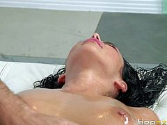 Completely naked oiled up brunette Breanne Benson shows off her beautiful wet body during rub down session. Round ass brunette gets her big boobs and her lovely shaved pussy massaged by hot masseur Keiran Lee.