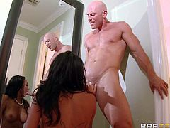 Gorgeous raven haired lady Breanne Benson with big natural boobs gets her tight bald pussy drilled by stiff cock without taking off her nice pink dress. She sucks and fucks non-stop to get enough!