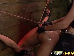 This naughty slave is tied up and bent over in the sex dungeon. She has a pussy pump used on her snatch and then, a big dildo shoved into her cunt hole. She is pounded hard by her mistress with a strapon.