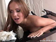 Sabrina pisses and licks it up, like the whore she is. Her pussy is wet and dripping in her stocking's. She rips a hole in nylons, to pleasure herself. Watch Sabrina bathes in her piss, as her clit fills your mouth salivating.