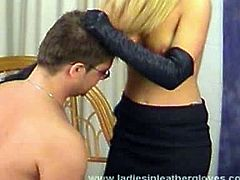 This blonde mistress has leather gloves on and a sexy leather skirt. She plays with her slave, torturing him in different ways, which aren't necessarily painful.