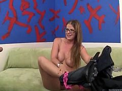 If you were wondering, how busty Anita's body looks like with no clothes on, be patient and you'll see her undressing completely on the couch. The blonde slutty milf wears eye glasses, which make her look more stylish and kinky. Click, to watch her performing a brilliant blowjob and an exciting tit job.