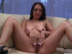 Four eyed brunette Miss Rican is a sexy sexy next door that puts her natural boobs on display and rubs her hot pussy with legs apart on camera. She does it for your viewing pleasure.