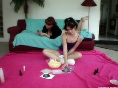 Ashlyn Rae sits on the floor and chats with Kylie Ireland. Kylie's cleavage reveals her huge titties. Ashlyn looks really innocent, like a shy, but curious teen.