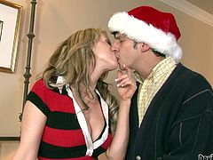 After a long Christmas party, Carolyn was really tired. It's not easy to handle so many guests in a Christmas party after all. But she has ways to relax herself, her dildo. She lies down on the couch, to fuck herself, but realizes, someone is standing over.