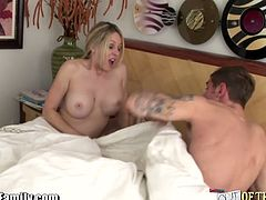 This milf gets in bed naked next to her daughter's husband. He becomes so horny that he fucks her butt. His wife catches them, but she doesn't get mad. She masturbates near them.
