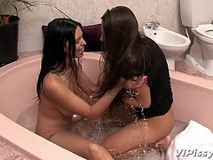 Kira and Mia love to take baths together. They love to feel each other's hot bodies and finger each other. Somehow, the presence of water makes them really hot and horny. No wonder the both of them lick each other's sexy pussy, before prepping up for some real hot sex. Watch the lesbians in action.