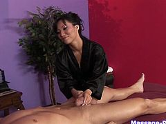 Exotic Asian masseuse gives good massage and tugjob to horny client