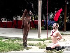 Lily and Nyomi, two horny lesbians, got out to play kinky. The brunette ebony milf is a very dominant bitch, while blonde Lily is more the obedient type. Her hands have been tied and her mouth is gagged, so she cannot scream. Click to watch busty Nyomi wearing a strap on and using it!