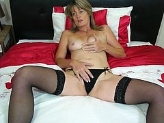 Di loves to spend some time alone, just as any sexy Milf does. For her, fun is not just about having wild sex. What she really likes to do more than anything, is to put her hand inside the panty and lie on the bed. She doesn't like to strip it all. She likes it slow and easy. So, watch this hot mature play with herself in the bed.