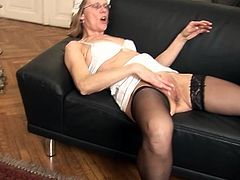 A Smut mature pair do love onto the sofa