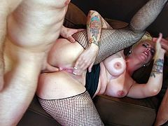 Chubby blonde babe in a fishnet pantyhose gets dp in a spirited mmf threesome