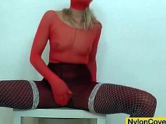 Red pantyhose girl gets horny and fucks a toy