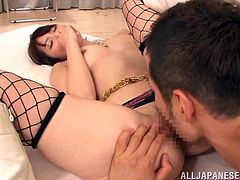 Sexy Asian babe spreads her legs and lets him lick and finger her hairy twat. He takes his sweet time exploring her pussy, but it's worth it. Yui sucks his cock, lets him fuck her tits, and cum in her mouth.