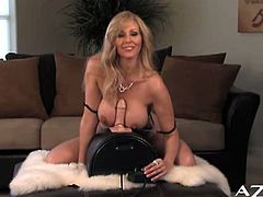After Julia Ann takes off her lovely lingerie, she turns on the sybian and puts her tits next to it.