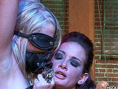 A handcuffed and blindfolded blonde-haired slut is freed from the fierce bond, so Tory could taste her appetizing cunt. See the busty mistress and the bitchy babe, performing incredible deep throat blowjobs. Also, watch Brooke eating the hot milf's pussy, while she is awfully fucked from behind by a masked guy.
