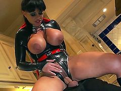 Kerry Louise is a Super MILF in sexy red and black super hero outfit. She shows off her amazing massive melons as she gets her snatch banged by Danny D in the kitchen in this cock-hardening XXX parody.