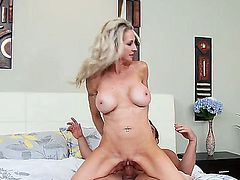 Good looking blond MILF Emma Starr with gorgeous body shows off her nice big melons and hot ass as he get her shaved pussy eaten out and fucked in steamy bedroom action. Watch busty mom Emma Starr  do it.