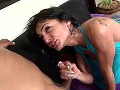 Buffed black guy fucks a white MILF cougar in this interracial video