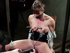 Do you enjoy watching porn that involves torturing helpless bitches? Pain and pleasure mix, as slutty Ariel has been awfully tied up in a fierce rope bondage. Her nipples and small tits have clothespins attached, while her mouth is gagged and the executor plays with her sexy cunt, using a vibrator. See details!