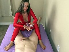 Handjob and footjob from hottie in red spandex