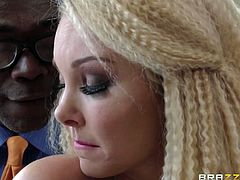 This cute blonde pornstar is ready for some hardcore action. She bends over and lets this black stud inspect her sweet, round butt. He kisses her bum and rubs her asshole, and pussy with his fingers. She is getting so turned on now!