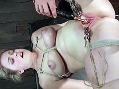 This chunky girl is tied up in the sex dungeon. The powerful master uses nipple clamps on her pussy lips, to spread them apart. He uses his electric prod and presses it against her clit, which send a pleasurable and painful sensation all throughout her body.