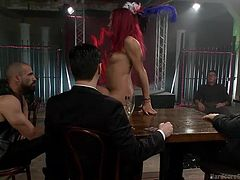 The bad girl is in the smoky basement of the club and she gets up on the table in the nude. She makes all the mean around her horny and pretty soon, she is grabbing stiff cock, and getting ready to be fucked. She sucks a cock and all the men around her, stiff their penises in her lovely face.