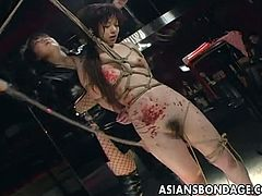 Skinny Asian babe is on the ropes enduring all of the bdsm activities her domina is doing to her. From spanking of her ass to the waxing of her body she likes it all.