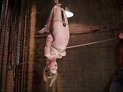 Do you find bonded girls attractive? If so, don't miss the crazy scenario, where a blonde-haired slut is strongly tied up with ropes. Ashley is hanging upside down and the creative bondage allows her to experiment brutal orgasms. The kinky sexy game supposes the use of a vibrator. Whipping also helps. Watch!