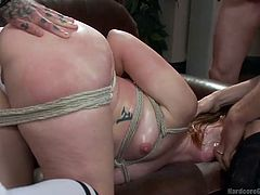 Naughty Claire undresses for a bunch of horny guys, that are about to use the redhead slutty babe in the dirtiest ways. The bitch shows off her small tits and appetizing buttocks, before getting bonded with ropes and mouth fucked. Watch the superb lady banged hard from behind!