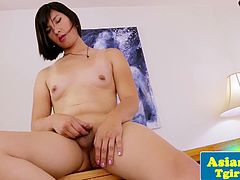 Asian pornstar tranny Natalie Chen wanks her tiny little cock and show her natural boobs