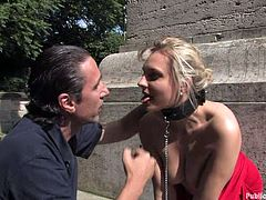 Every passer by can see Kitty disgraced. The bitch has been blindfolded by a dominant guy, who wants to treat her no less than she deserves, meaning to humiliate her publicly. The blonde-haired slut wears shackles and a neck collar. Watch her breast revealed with lust. Her ass is also available!