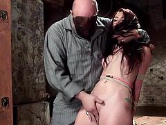 A helpless slut with long aubergine hair finds herself in the hands of a masked dominant guy, who tied her up in a strong rope bondage. The man plays with her as she were a puppet, who got angry on and wants to punish. See Mandy wearing a ball gag. After her panties are removed, her pussy is fingered deep...