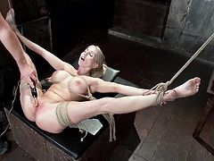 Christie is hogtied like and slut and the master opens up her legs wide with the help of rope. Now, that he has access to her vagina, he takes out his prod and gives her a nice shock. The electric current goes from her clitoris all the way through her entire body and she moans.