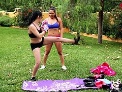 After nice workout in the park, these two lovely ladies lay down the blankets and have a nice rest. The sexy babes massage each other's aching muscles and now, they are feeling much more relaxed. One chick even gets her sweet bum rubbed.