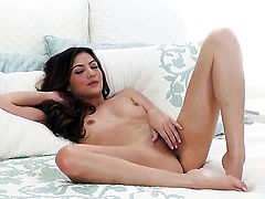 Cassie Laine with small tits and shaved cunt does striptease before playing with her honeypot