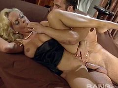 Glamorous blond Kelly Trump enjoys a nice long anal fuck