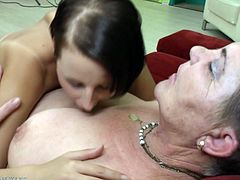 Izabelle is a very horny granny, who loves to get satisfied by younger girls. Now she is sitting on the couch and getting ridden by a young lesbian, who has a fancy for pleasing her big appetite, by kissing and licking her body passionately, almost eating her breasts, and going down between her legs.