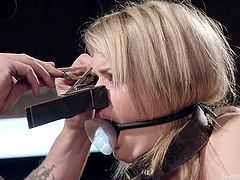 blonde slut gets huge clamps put on her face and nipples