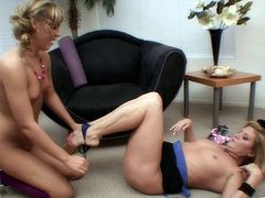 Lesbian cougar with big tits getting her pussy licked in her living room